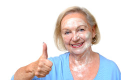Smiling happy elderly woman wearing a face mask Royalty Free Stock Photos