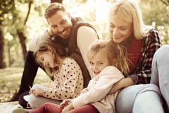 Smiling happy family in nature. stock photo