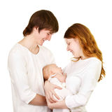 Smiling happy family with newborn Stock Photos