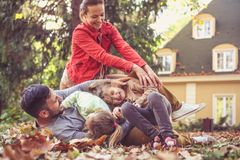 Smiling happy family playing together outside. On the move. stock image