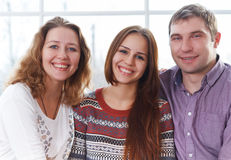 Smiling happy family with teenage daughter Stock Image
