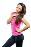 Happy female fitness model looking at camera Royalty Free Stock Images