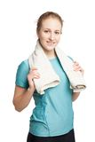 Smiling happy female fitness model with a towel Stock Image