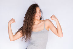 Smiling and happy fitness young woman and strength arms. Young woman happy fitness smile Stock Photo