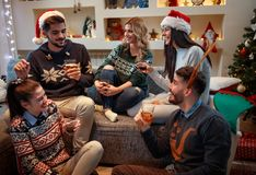 Happy friends celebrate Christmas. Smiling happy friends celebrate Christmas Royalty Free Stock Images