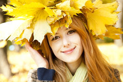 Smiling happy girl in autumn leaves. Stock Photos