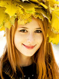 Smiling happy girl in autumn leaves. Royalty Free Stock Photo