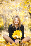 Smiling happy girl in autumn park Stock Image