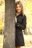 Smiling happy girl in autumn park Royalty Free Stock Photo