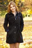 Smiling happy girl in autumn park Royalty Free Stock Images