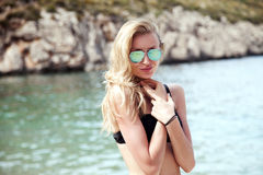 Smiling happy girl on the beach. Royalty Free Stock Images