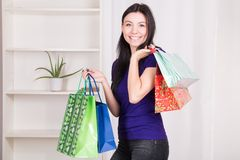 Smiling happy girl buys a bag gifts for Christmas Stock Photo