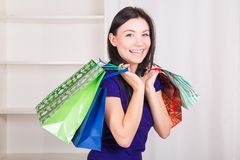Smiling happy girl buys a bag gifts for Christmas Stock Images