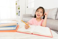 Smiling happy girl children writing homework. Ready back to school studying and having good idea about learning new things stock images