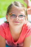 Smiling happy girl in glasses Royalty Free Stock Image