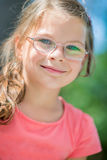 Smiling happy girl in glasses Stock Images