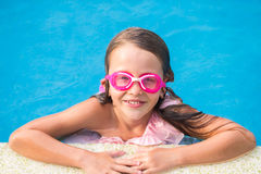 Smiling happy girl in goggles for swimming at Stock Photo