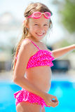 Smiling happy girl in goggles for swimming at outdoor pool Royalty Free Stock Image