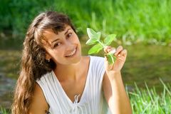 Smiling happy girl with mint Royalty Free Stock Photo