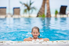 Smiling happy girl in outdoor swimming pool Royalty Free Stock Photo