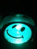 Smiling happy green traffic light. Green trafficlight covered with black smileyface Stock Photography