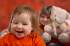 Smiling, Happy Handicapped Girl. A bright smile on this happy young girl, almost two years old, with Downs Syndrome stock image