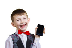 Smiling Happy, Joyful beautiful little boy holding mobile phone Stock Images