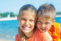 Smiling happy kids on the beach Stock Photos