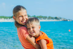 Smiling happy kids on the beach Royalty Free Stock Photo