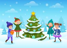 Smiling happy kids having fun standing at decorated Christmas tree in winter forest. Winter holidays card. Smiling happy kids having fun standing at decorated Stock Image