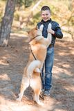 Happy little boy walking with dog in the park. Animal concept. Smiling happy little boy having fun with doggie in the park outdoors. Cute kid with puppy playing Royalty Free Stock Images