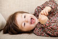 Smiling and happy little girl Stock Photos
