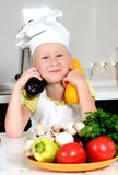 Smiling happy little girl in a cooks uniform Stock Photography