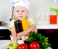 Smiling happy little girl in a cooks uniform Royalty Free Stock Photos