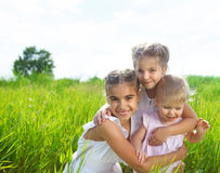 Smiling happy little girls on meadow Royalty Free Stock Images