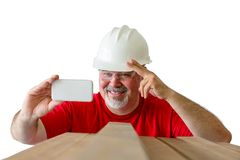 Smiling happy lumberman taking a selfie at work stock photography