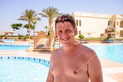 Smiling happy male tourist at a resort Stock Photos