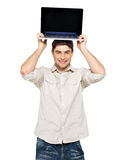 Smiling happy man with laptop on head Royalty Free Stock Photos