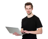 Smiling happy man with laptop Stock Images