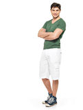 Smiling happy man in white shorts and green t-shirt. Full portrait of smiling happy handsome man in white shorts and green t-shirt - isolated on white background Stock Image