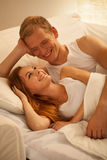 Smiling happy married couple. Lying in bed Stock Photography