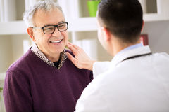 Smiling happy patient visit doctor. Smiling happy old patient visit doctor royalty free stock photo