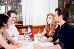 Smiling happy people in restaurant Stock Image