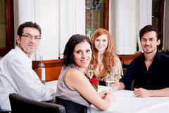 Smiling happy people in restaurant Stock Images