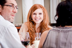 Smiling happy people in restaurant Royalty Free Stock Images