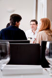 Smiling happy people in restaurant Royalty Free Stock Photography