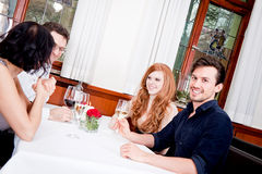 Smiling happy people in restaurant Stock Photos