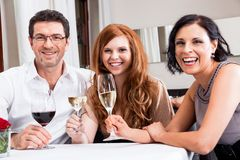 Smiling happy people in restaurant Royalty Free Stock Photos