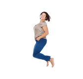 Smiling happy plus size woman jumping high in air Royalty Free Stock Photography
