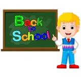 Smiling happy schoolchildren with green banner Blackboard Royalty Free Stock Photos